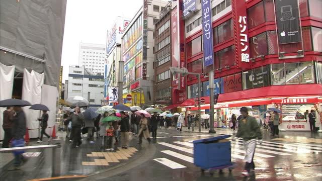 WS SIDE POV Street scene in Akihabara, Tokyo, Japan