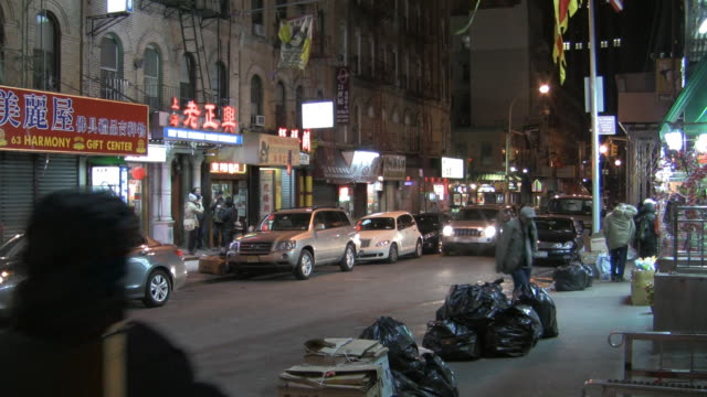 ms, street scene in chinatown at night, new york city, new york, usa - müllsack stock-videos und b-roll-filmmaterial
