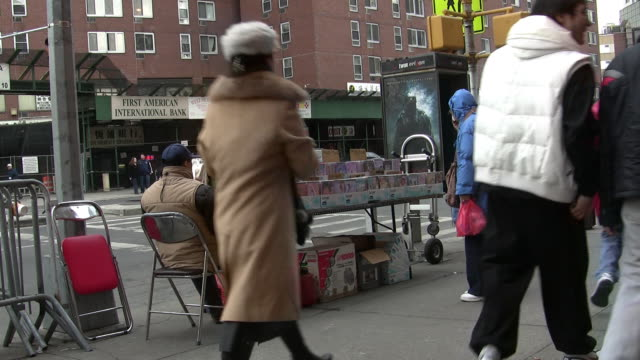 MS, Street scene in Chinatown with video pirate stand, New York City, New York, USA