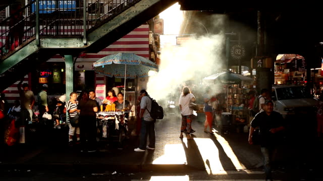 street scene in jackson heights queens nyc - market trader stock videos & royalty-free footage