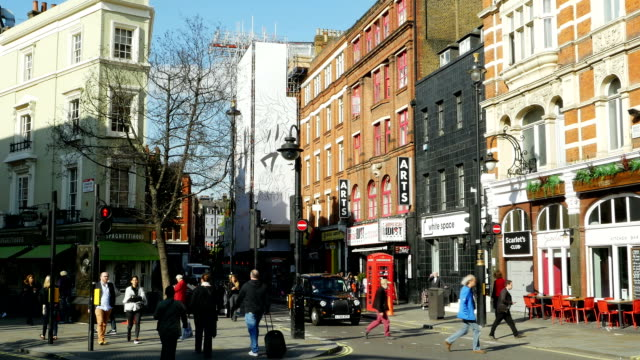 street scene in london great newport street (4k/uhd to hd) - west end london stock videos and b-roll footage