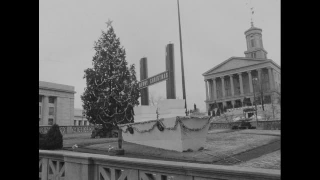 Street scene in Nashville in early December 1965 or 1966 showing both a Christmas tree and manger scene