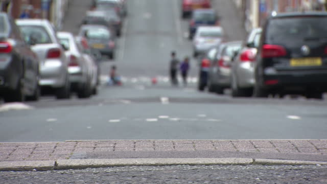 street scene in residential street in blackburn, as coronavirus cases in the area spike and they are at risk of going into a local lockdown - city life stock videos & royalty-free footage