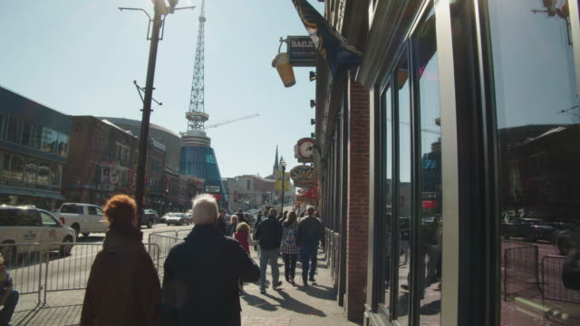 street scene in the daytime. outdoor shots of city scenes in nashville, tennessee during winter. - tennessee stock videos & royalty-free footage