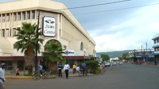ws, street scene, kisumu, kenya - fan palm tree stock videos and b-roll footage