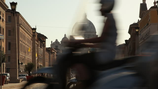 ws street scene near st peter's basilica / rome, italy - motorino video stock e b–roll