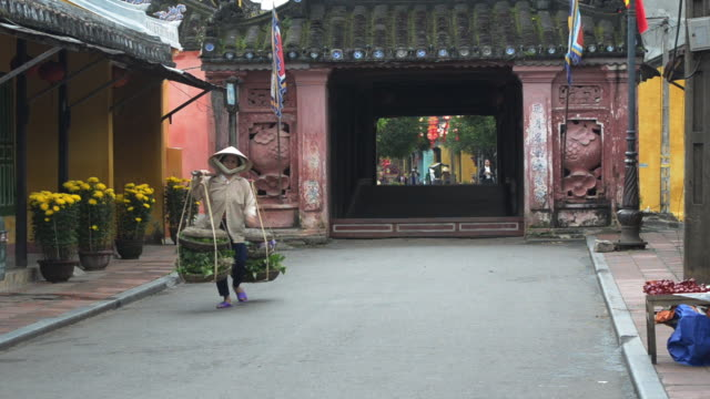 Street scene next to Japanese bridge, early morning. Hoi An, Vietnam