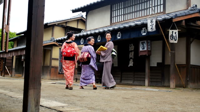Street Scene of People in a Traditional Japanese Village
