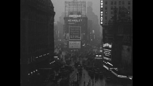 street scene on rainy broadway as seen from times square: pedestrians, traffic, billboards, loew's new york theater at right / note: exact year not... - 1920 stock videos & royalty-free footage