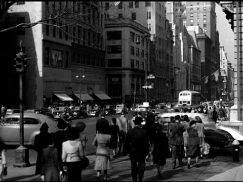 stockvideo's en b-roll-footage met street scene people walking crowded sidewalk political commentator sumner welles speaking at podium ms 'the time for decision' books by welles on... - commentator