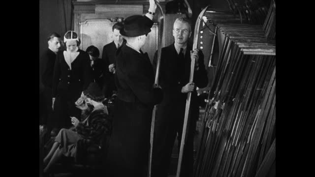 vidéos et rushes de boston street scene reprising conversation railroad men sitting in office talking about routing special train for weekend skiers people walking at... - 1937