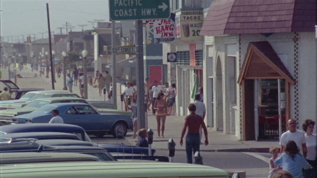 ws street scene with car and pedestrian traffic / newport beach, california, usa - 1966 stock videos and b-roll footage