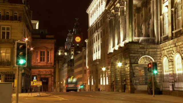 T/L, MS, Street scene with clock tower of Royal Liver Building in background, night, Liverpool, England