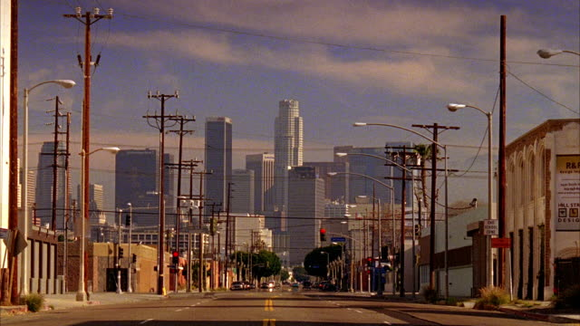 WS, Street scene with downtown skyline in background, Los Angeles, California, USA