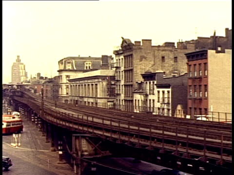 1940 ws pan street scene with elevated train passing by / new york city, new york, usa - 1940 stock videos and b-roll footage