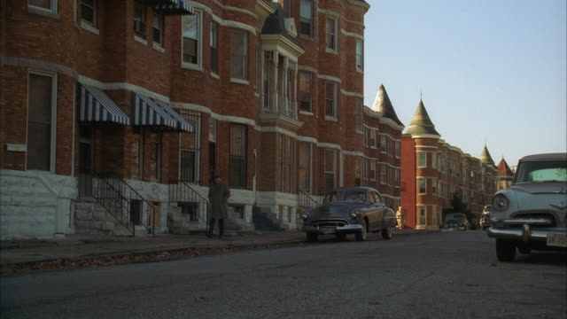 ws pan street scene with french chateau style row houses and 1950's cars / baltimore, maryland, usa - moving past video stock e b–roll