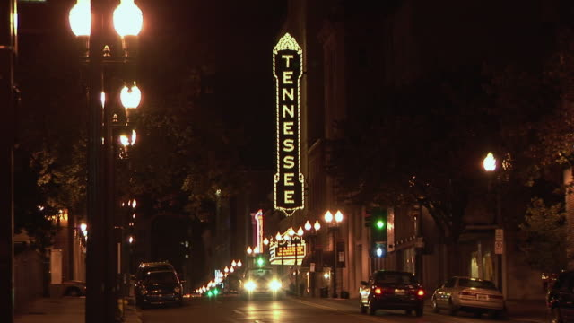 WS, Street scene with historic Tennessee Theatre sign illuminated at night, Knoxville, Tennessee, USA