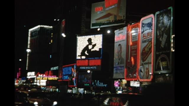1954 ws street scene with neon, new york city, new york, united states - 1954 stock-videos und b-roll-filmmaterial