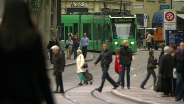ws street scene with pedestrians and tram / basel, switzerland - commercial land vehicle stock videos & royalty-free footage