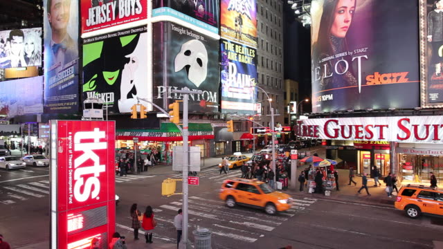 ws street scene with traffic and neons illuminated at night / broadway, new york city, usa - broadway manhattan stock videos & royalty-free footage