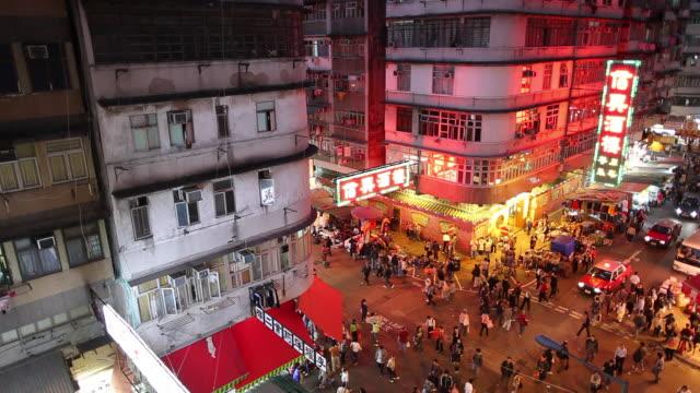 WS HA Street scene with traffic and neons illuminated at night / Hong Kong, China