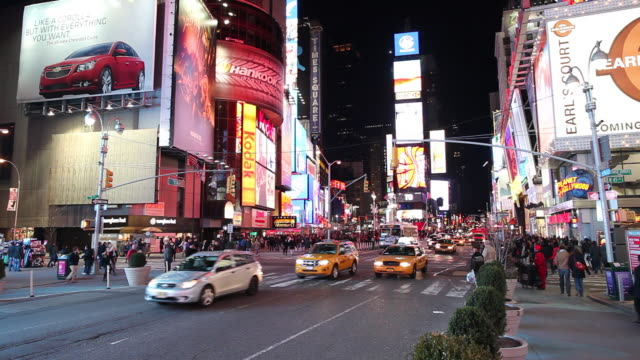 WS Street scene with traffic and neons illuminated at night / Times Square, New York City, USA