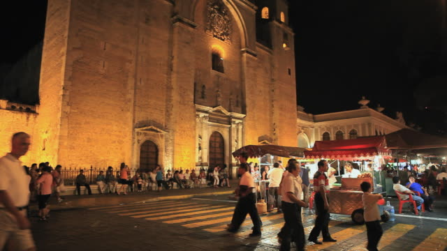 WS Street scene with vendors and tourists outside cathedral, Merida, Yucatan, Mexico