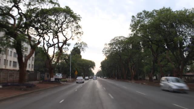 street scenes harare - repubblica dello zimbabwe video stock e b–roll