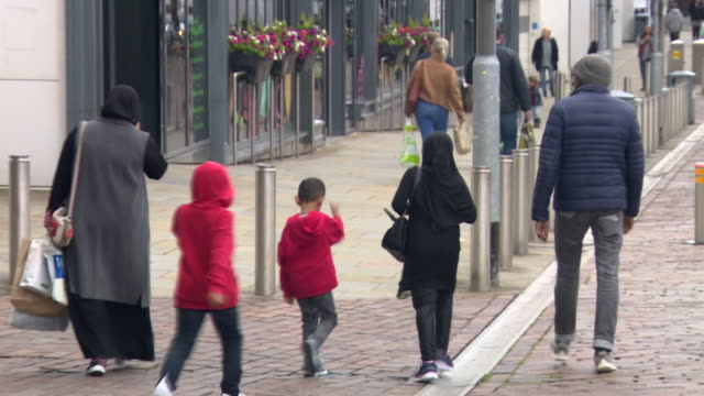 street scenes in blackburn which is seeing a spike in the rate of local coronavirus infections - asian and indian ethnicities stock videos & royalty-free footage