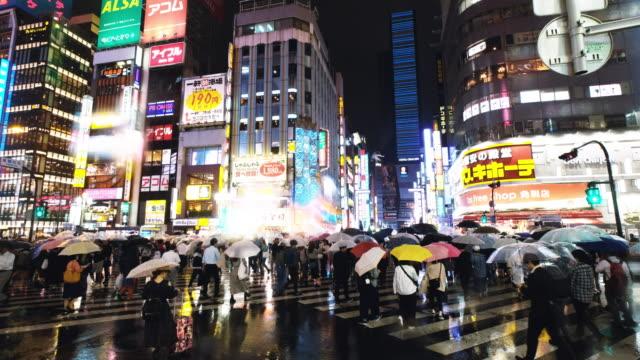 street scenes in kabukicho on a rainy night - tourist stock videos & royalty-free footage