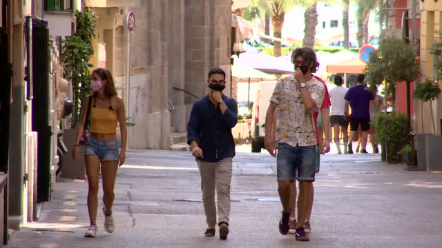 street scenes in palma, majorca, with people wearing face masks during coronavirus pandemic - majorca stock videos & royalty-free footage