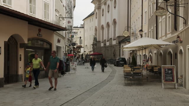 "street scenes in salzburg as it starts to reopen to locals following coronavirus lockdown - ""bbc news"" stock-videos und b-roll-filmmaterial"