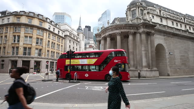 street scenes near building of bank of england in city of london, london, england, u.k., on thursday, august 5, 2021. the bank of england may move a... - double decker bus stock videos & royalty-free footage