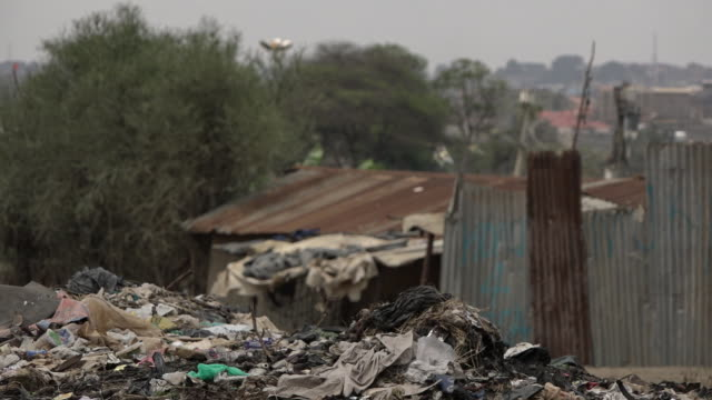 street scenes of daily life in nairobi slum in kenya - nairobi stock videos and b-roll footage