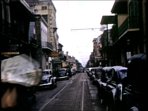 street scenes of new orleans cars parked on street buildings new orleans on july 01 1941 in new orleans louisiana - personal land vehicle stock videos & royalty-free footage