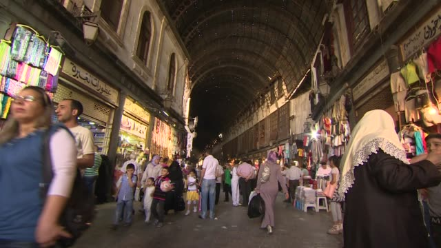Street scenes of people shopping in AlHamidyah Souq in Old Town Damascus Syria