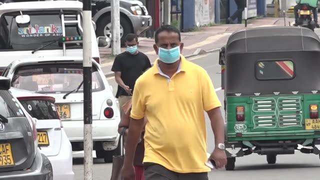 street scenes of sri lankans wearing face masks in colombo during coronavirus pandemic - sri lanka stock videos & royalty-free footage