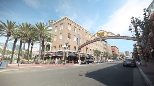 Street scenes of the Gaslamp Quarter in San Diego California Shot of vehicle traffic driving underneath the signage of the Gaslamp Quarter reading...