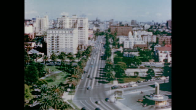 1947 street scenes of la with traffic and well-known buildings including city hall, the civic center, hall of justice, city hospital and the federal building - anno 1947 video stock e b–roll