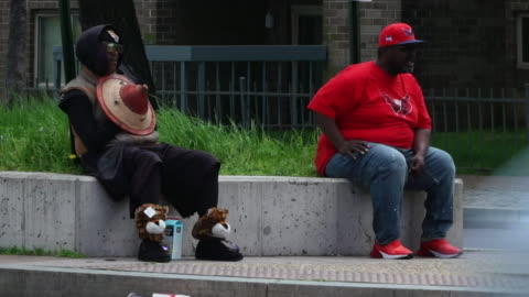 street scenes showing the black american community in washington during the coronavirus crisis, some wearing masks, who seem to be infected more with... - population explosion stock videos & royalty-free footage