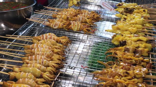 Street seafood in night market , Bangkok , Thailand