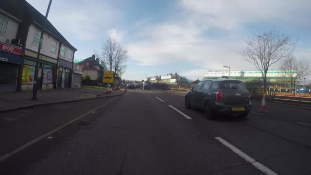WS POV Street seen from moving car / England, London, United Kingdom