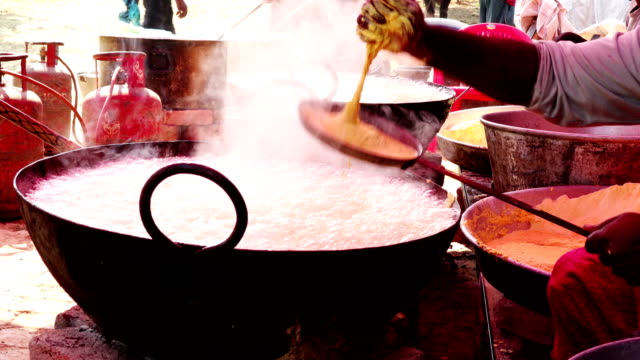 street seller frying indian dish - boiling stock videos & royalty-free footage