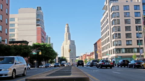 a street shot of brooklyn with the iconic williamsburg savings bank tower in the background. - establishing shot bildbanksvideor och videomaterial från bakom kulisserna