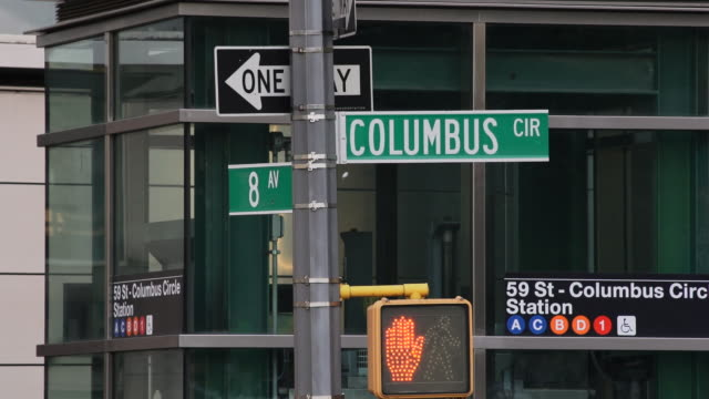 street sign at the corner of columbus and 8th ave.  the 59th street subway station is behind. - western script stock videos & royalty-free footage