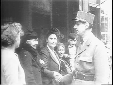 street sign church and statue holding flags in normandy / allied ground commander british general bernard montgomery greets king george vi / king... - la manche stock videos and b-roll footage
