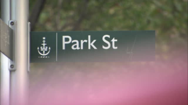 a street sign directs traffic to park street. - road sign stock videos & royalty-free footage