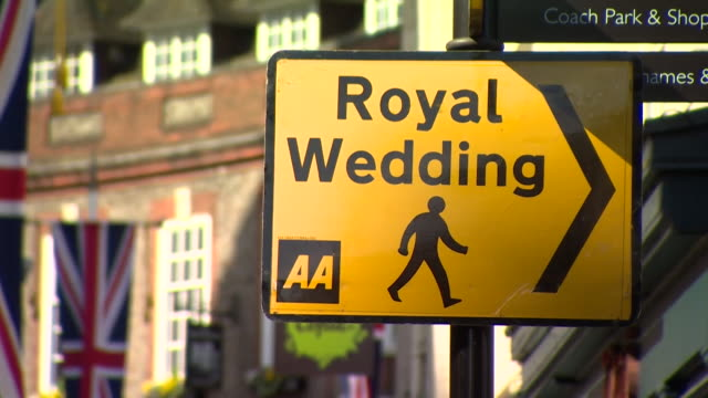 a street sign giving directions for the royal wedding of prince harry and meghan markle in windsor - prince harry stock videos and b-roll footage