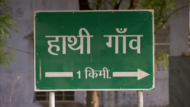 street sign in jaipur, india. available in hd - road sign stock videos & royalty-free footage