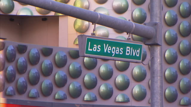 a street sign indicates las vegas boulevard. - the strip las vegas stock videos & royalty-free footage